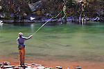 Caucasian fly fisherman, angler, at Maroon Lake in the Maroon Bells Snowmass Wilderness Area, near Aspen, Colorado, USA