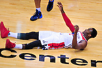 John Wall of the Wizards hits the floor after colliding with another player. New York defeated Washington 115-104 during a NBA preseason game at the Verizon Center in Washington, D.C. on Friday, October 9, 2015.  Alan P. Santos/DC Sports Box