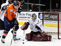 Tigers center Jeremy Colliton tries to get a shot past San Antonio goalie Josh Tordjman during the first period of the AHL game between the Bridgeport Sound Tigers and the San Antonio Rampage, Nov. 18, 2008, at the AT&T Center in San Antonio. (Darren Abate/pressphotointl.om)