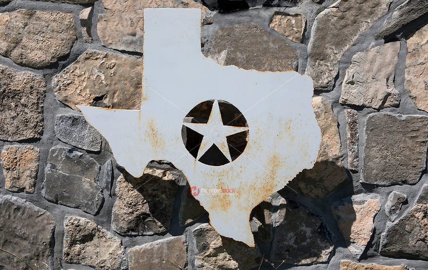 Rustic metal cutout of the shape of the State of Texas and inset Lone Star emblem.