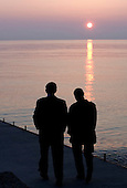United States President George W. Bush and President Vladimir Putin of Russia take a sunset walk on a pier along the Black Sea during a visit by President and Mrs. Bush Saturday, April 5, 2008, to the President Putin's summer retreat, Bocharvo Ruchey, in Sochi, Russia.  .Mandatory Credit: Eric Draper / White House via CNP