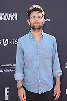 LOS ANGELES - OCT 8:  Adam Scott at the P.S. ARTS' Express Yourself 2017 at the Barker Hanger on October 8, 2017 in Santa Monica, CA