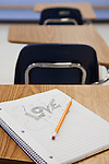 USA, Illinois, Metamora, Pencil and notepad on desk in classroom