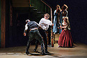London, UK. 22.05.2015. THE BEAUX' STRATAGEM, by George Farquhar, directed by Simon Godwin, opens in the Olivier, at the National Theatre. Lighting design by Jon Clark, set and costume design by Lizzie Clachan, movement by Jonathan Goddard. Picture shows: Mark Rose (Hounslow), Samuel Barnett (Aimwell), Susannah fielding (Mrs Sullen), Pippa Bennett-Warner (Dorinda), Amy Morgan (Cherry). Photograph © Jane Hobson.