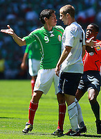 Action photo of Guillermo Franco (L) of Mexico and Michel Bradley of USA, during World  Cup 2010 qualifier game against USA at the Azteca Stadium./Foto de accion de Guillermo Fraco (I) de Mexico y Michael Bradley de USA durante juego eliminatorio de Copa del Mundo 2010 en el Estadio Azteca. 12 August 2009.