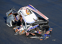 Apr. 13, 2012; Concord, NC, USA: The remaining pieces to the body of the car driven by NHRA funny car driver Matt Hagan following an explosion during qualifying for the Four Wide Nationals at zMax Dragway. Mandatory Credit: Mark J. Rebilas-