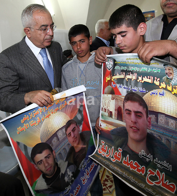 Palestinian prime minister Salam Fayyad paying condolences to families of martyrs Mohammed Faisal Kawareek and  Salah Kamel Kawareek of Awarta village in the West Bank city of Nablus on March 22,2010. Photo by Mustafa Abu Dayeh\ Pool