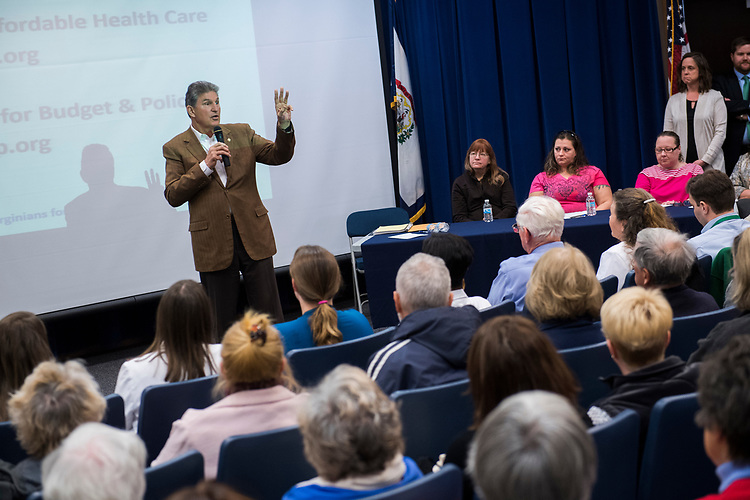 UNITED STATES - MARCH 16: Sen. Joe Manchin, D-W.Va., conducts a town hall meeting at the WVU Robert C. Byrd Health Sciences Center in Martinsburg, W.Va., March 16, 2017. Much of the discussion was regarding the American Health Care Act, the Republican's plan to repeal and replace the ACA. (Photo By Tom Williams/CQ Roll Call)