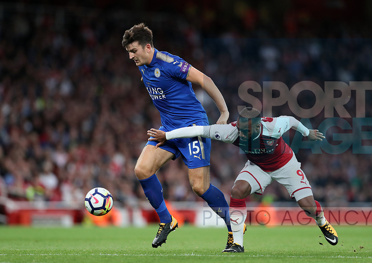 Arsenal's Alexandre Lacazette tussles with Leicester's Harry Maguire during the premier league match at the Emirates Stadium, London. Picture date 11th August 2017. Picture credit should read: David Klein/Sportimage