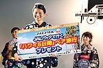 July 27 2012, Tokyo, Japan  The winner Shoko Kondo shows a JALPAK trip to Hawaii from Japan Airlines sponsor at Yukata Beauty Contest in Koichi Festival. Shoko Kondo, one of the 10 finalists of 270 candidates, wins the annual Yukata Beauty Festival at Koichi Festival in Shimbashi, Tokyo. (Photo by Rodrigo Reyes Marin/AFLO)..