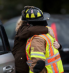 BETHLEHEM, CT 21 DECEMBER- 122112JS05- A Bethlehem Volunteer firefighter receives a hug during the funeral for Rachel D'Avino Friday at the Church of the Nativity in Bethlehem. D'Avino was  a behavioral therapist at Sandy Hook Elementary School in Newtown.  .Jim Shannon Republican American
