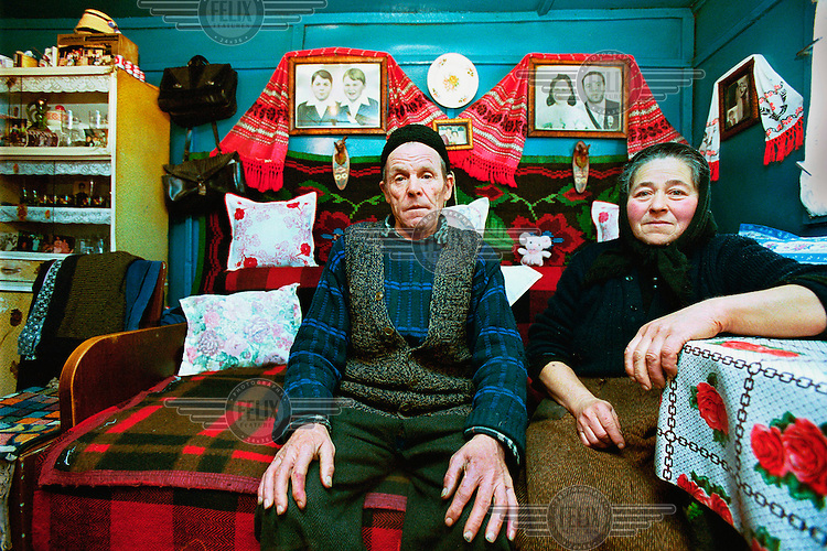 "Doina (62) with her husband. ""We didn't have it bad in the old times, but now it is better for us. In 1991 the government gave us our land back. We now grow  sheep, pigs, cows and have our own vegetable garden."""