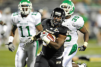 1 September 2011:  FIU's Darriet Perry (28) runs for a touchdown in the second half as the FIU Golden Panthers defeated the University of North Texas, 41-16, at University Park Stadium in Miami, Florida.