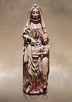 Gothic alabaster statue of Saint Anne and the Virgin Mary as a child from the Nottingham School England, 15th Century, from the cemetery of the vall de Bertizana, Nivarra.  National Museum of Catalan Art, Barcelona, Spain, inv no: MNAC  4353. Against a art background.
