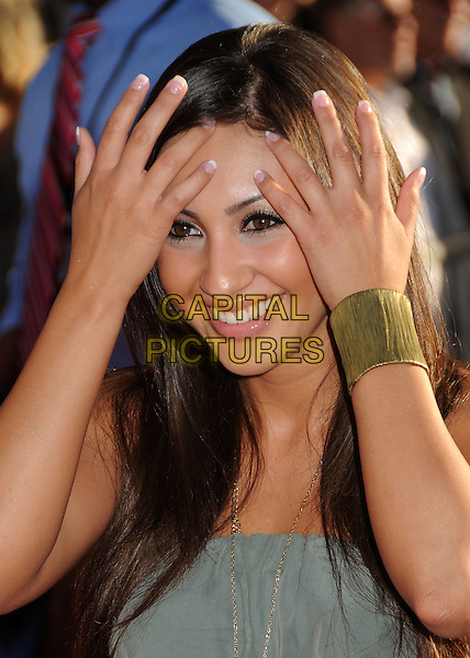 "Francia Raisa.Premiere of ""Captain America: The First Avenger"" held at The El Capitan Theatre in Hollywood, California, USA..July 19th, 2011.headshot portrait grey gray smiling hands cuff gold bracelet.CAP/ADM/BP.©Byron Purvis/AdMedia/Capital Pictures."