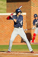 Ryan Cordell (9) of the Liberty Flames at bat against the High Point Panthers at Willard Stadium on March 23, 2013 in High Point, North Carolina.  The Panthers defeated the Flames 9-3.  (Brian Westerholt/Four Seam Images)