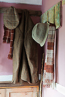 In the entrance hall hats and coats hang on home-made pegs