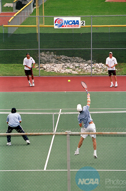 23 May 2001:   Overview of court showing doubles action, farcourt (L-R) Ed Rahn and Sloan Rush of Trinity (Texas) against near court (L-R) Derek Fitzpatrick and Nick Cunningham of U. of California - Santa Cruz during the 2001 Division 3 Men's Tennis Championships' Double Final held at DePauw University in Greencastle, IN. Fitzpatrick and Cunningham won the doubles championship.© Marilyn Culler / NCAA Photos