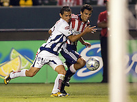 Chivas defender Jonathan Bornstein (13)  races Pachuca defender Leobardo Lopez (2)   for a loose ball. Pachuca CF defeated the Chivas USA 2-1 during the 1st round of the 2008 SuperLiga at Home Depot Center stadium, in Carson, California on Sunday, July 13, 2008.