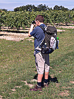 Young boy photographing his family whilst on holiday in France..©shoutpictures.com..john@shoutpictures.com