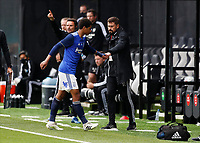 4th July 2020; Craven Cottage, London, England; English Championship Football, Fulham versus Birmingham City; Jude Bellingham of Birmingham City giving a fist bump to Birmingham City manager Pep Clotet after being subbed off during the 2nd half