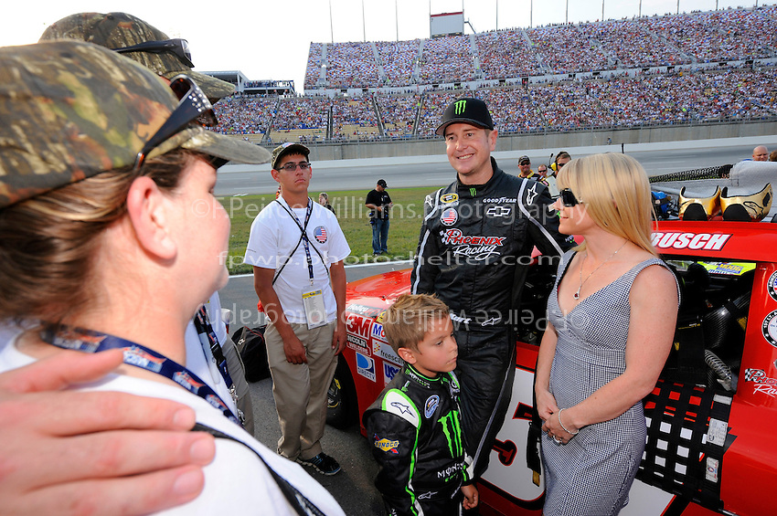 Driver Kurt Busch poses for pics on the grid.