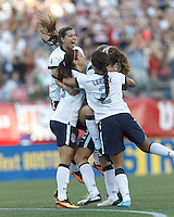 USWNT defender Kristie Mewis (8) celebrates her goal with teammates. In an international friendly, the U.S. Women's National Team (USWNT) (white/blue) defeated Korea Republic (South Korea) (red/blue), 4-1, at Gillette Stadium on June 15, 2013.