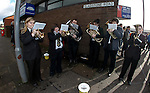 Brass band playing for the supporters outside Ochilview