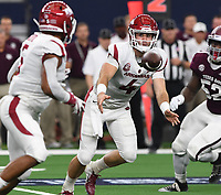 NWA Democrat-Gazette/J.T. WAMPLER Arkansas' Ty Storey pitches the ball to Rakeem Boyd Saturday Sept. 29, 2018 against Texas A&M at AT&T Stadium in Arlington. Arkansas lost 17-24.