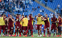 Calcio, Serie A: Lazio vs Roma. Roma, stadio Olimpico, 25 maggio 2015.<br /> Roma's players celebrate past Lazio's Danilo Cataldi at the end of the Italian Serie A football match between Lazio and Roma at Rome's Olympic stadium, 25 May 2015. Roma won 2-1.<br /> UPDATE IMAGES PRESS/Riccardo De Luca