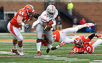 Ohio State Buckeyes running back Carlos Hyde (34)  runs for a gain in first half  at Memorial Stadium in Champaign, Illinois on November  16, 2013.  (Chris Russell/Dispatch Photo)