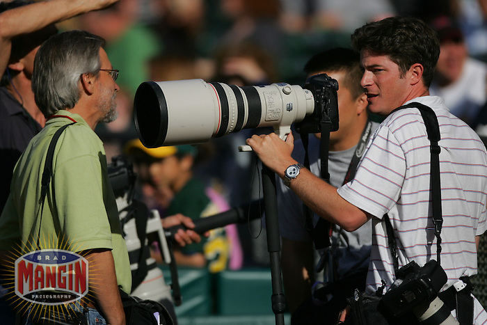 OAKLAND, CA - JUNE 4: Photographer Jed Jacobsohn gets ready before the game between the Toronto Blue Jays and Oakland Athletics at the Oakland-Alameda County Coliseum in Oakland, California on June 4, 2005. Photo by Brad Mangin