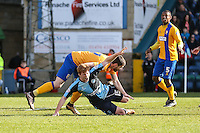 Ryan Sellers of Wycombe Wanderers (15) is challenged by Daniel Alfei of Mansfield Town in the visitor's penalty box during the Sky Bet League 2 match between Wycombe Wanderers and Mansfield Town at Adams Park, High Wycombe, England on 25 March 2016. Photo by David Horn.
