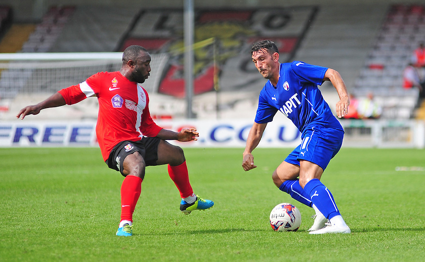 Chesterfield's Gary Roberts vies for possession with Lincoln City's Sahr Kabba<br /> <br /> Photographer Chris Vaughan/CameraSport<br /> <br /> Football - Friendly - Lincoln City v Chesterfield - Saturday 19th July 2014 - Sincil Bank Stadium - Lincoln<br /> <br /> &copy; CameraSport - 43 Linden Ave. Countesthorpe. Leicester. England. LE8 5PG - Tel: +44 (0) 116 277 4147 - admin@camerasport.com - www.camerasport.com