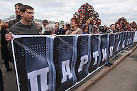 Moscow, Russia, 06/05/2013..Protesters with a banner designed as police riot shields in Bolotnaya Square as some 20,000 demonstrators protested against Russian President Vladimir Putin and demanded the release of political prisoners. The demonstration marked the first anniversary of a protest that descended into violence between protestors and police and resulted in over 600 arrests.