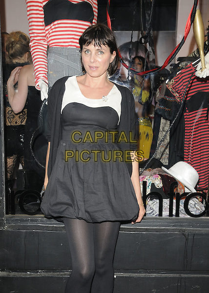 SADIE FROST .At the Cirque Du FrostFrench event, FrostFrench boutique Soho, London, England, UK,  14th July 2010..half length black dress bubble hem puffball cardigan white tights .CAP/CAN.©Can Nguyen/Capital Pictures.