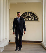 United States President Barack Obama walks along the colonnade of The White House to the Oval Office, Wednesday, January 27, 2010 in Washington, DC. Later this evening, while facing declining popularity among the American people, Obama will give his first State of The Union address in which he is expected to call for, among other things, tax cuts for the middle class and a three year freeze on discretionary spending. .Credit: Chris Kleponis - Pool via CNP