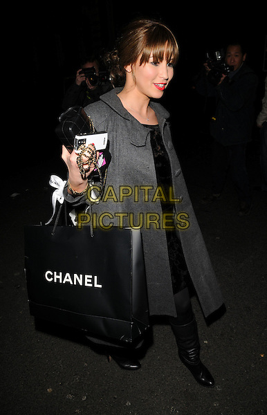 RACHEL STEVENS.Finch and Partners Pre-Bafta Party held at Mark's Club, Mayfair, London, England..February 9th 2008.full length black dress boots goody bag grey gray coat jacket .CAP/CAN.©Can Nguyen/Capital Pictures