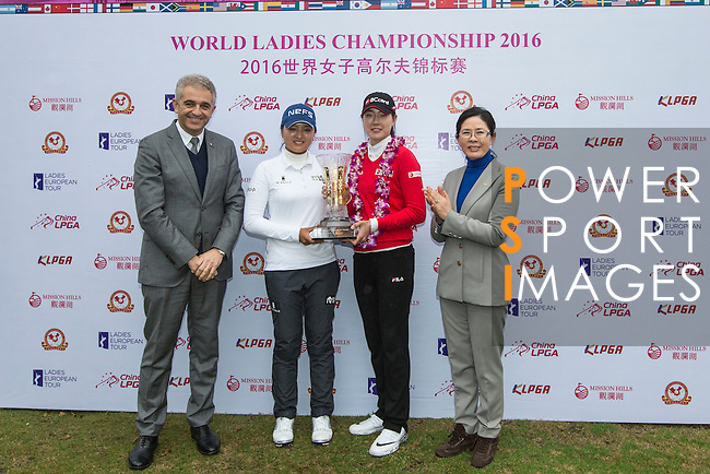 The winning team, Jung Min Lee of South Korea (right), and Jin Young Ko of South Korea (left) receive the trophy from the hands of Ivan Khodabakhsh (left) and Lee Young Kyu (right) during the Prize giving ceremony of the World Ladies Championship 2016 on 13 March 2016 at Mission Hills Olazabal Golf Course in Dongguan, China. Photo by Victor Fraile / Power Sport Images