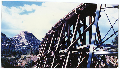 Color photo of Lightner Creek trestle with Twin Buttes in background.<br /> RGS  Lightner Creek Trestle at MP159 ?, CO
