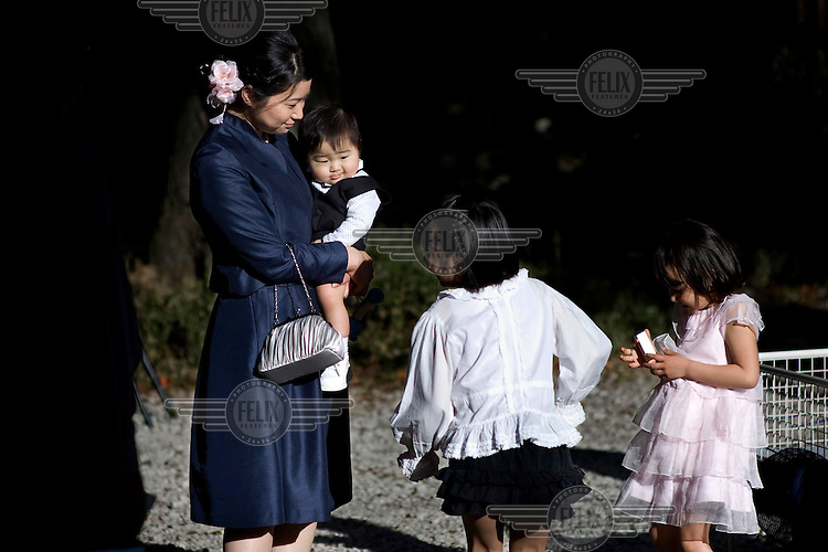 A nanny looks after some children children during a Shinto wedding at the Meiji Jingu Shinto Shrine. /Felix Features
