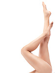 Closeup of smooth long bare woman legs pointing up isolated on white background