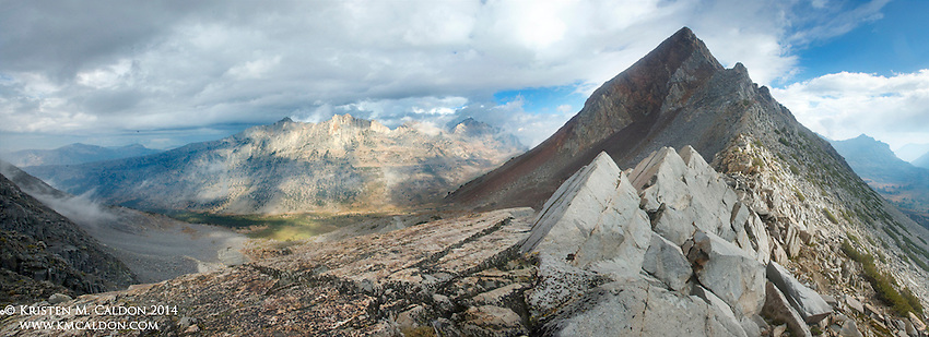 The dramatic panorama from Stanton Pass as a late summer storm passes by Virginia Peak in Yosemite National Park.