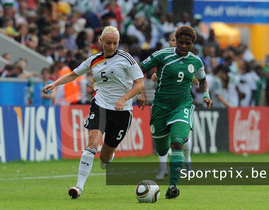 Germany - Nigeria : duel tussen Desire OPARANOZIE (9) en Kristina Gessat (5)<br /> foto David Catry / nikonpro.be