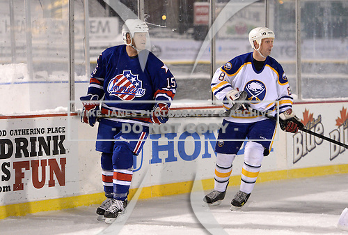 Randy Cunneyworth (15) and Darryl Shannon (8) during The Frozen Frontier Buffalo Sabres vs. Rochester Amerks Alumni Game at Frontier Field on December 15, 2013 in Rochester, New York.  (Copyright Mike Janes Photography)