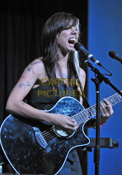"""CHRISTINA PERRI .Christina Perri performs as part of the """"Q92.9 Fall Ball - Think Pink Benefit"""" to benefit the Susan G. Komen Foundation held at The Altar Bar, Pittsburgh, PA, USA..October 19th, 2010.stage concert live gig performance music half length black top tattoo writing guitar singing .CAP/ADM/JN.©Jason L Nelson/AdMedia/Capital Pictures."""