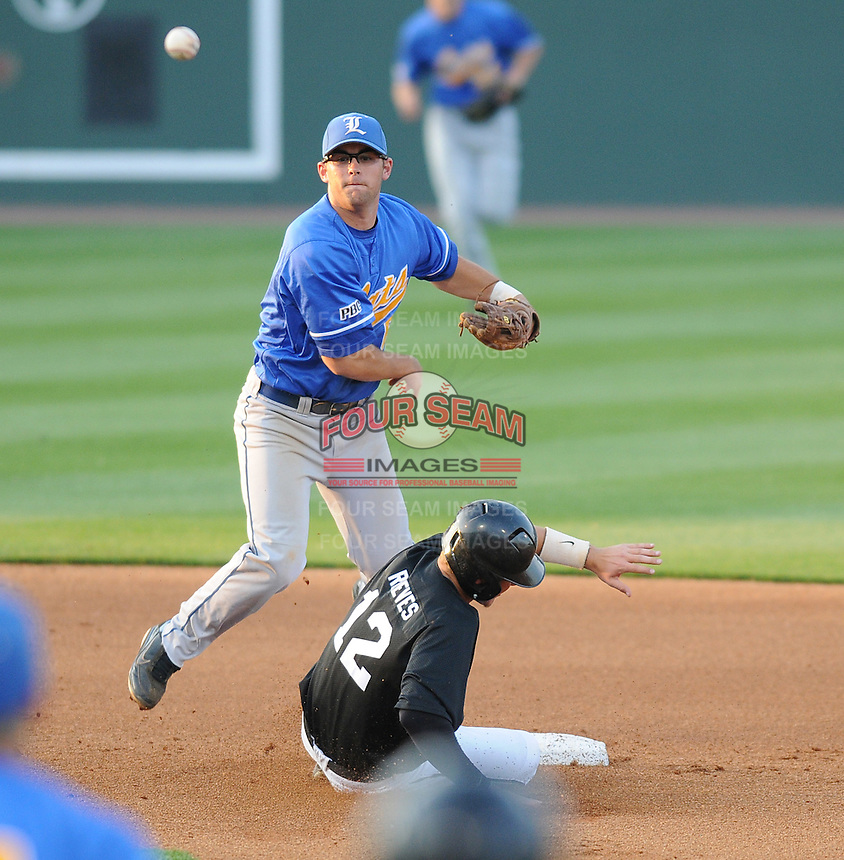 Second baseman Erik Lunde (6) of the Lander University Bearcats makes the putout on Zach Reeves (12) of the Anderson University Trojans and turns the double play in a game on March 28, 2012, at Fluor Field in Greenville, South Carolina. Lander won, 6-5. (Tom Priddy/Four Seam Images).