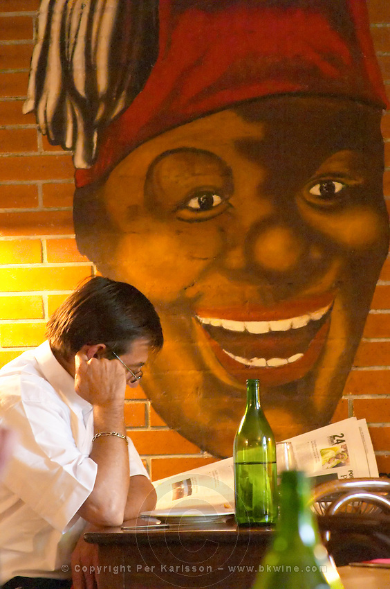 man reading paper restaurant le bistrot crozes hermitage rhone france