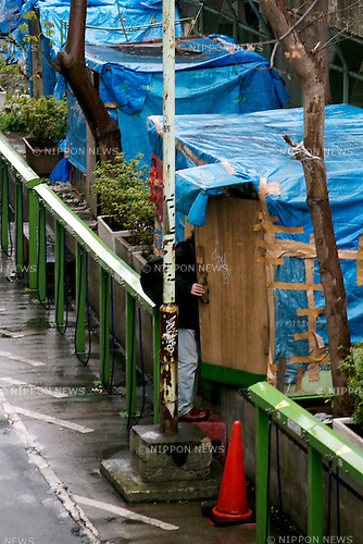 A homeless enters to his house in Miyashita Park on April 10, 2015, Tokyo, Japan. Shibuya Ward is aiming to improve the image of Miyashita Park in 2016. The last refurbishment program, supported by Nike Japan under a Naming Rights Agreement, ended up in 2011. Before the renovation work begins the plan is to move all the homeless currently living in the park to a different location. Shibuya is one of the many areas of Tokyo aiming to boost its image before the 2020 Tokyo Olympic Games. (Photo by Rodrigo Reyes Marin/AFLO)