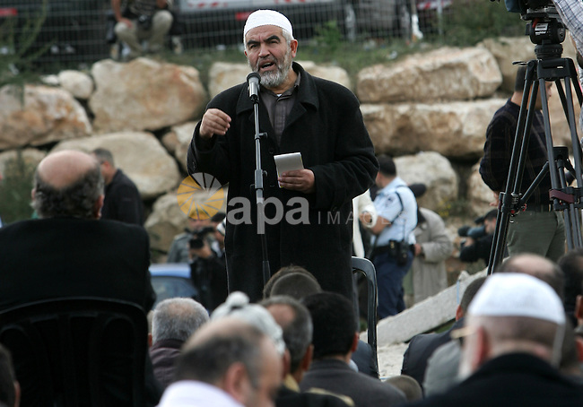 Head of the islamic movement in Israel,Sheikh Raed Salah attends Friday prayers near the house of the evicted Palestinian Kurd family in east Jerusalem's the Sheikh Jarrah neighbourhood on December 4, 2009. Photo by Mohamar Awad
